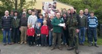 Fergal Diamond presents Ian Rowan with a cheque for £400 from Moyola Anglers